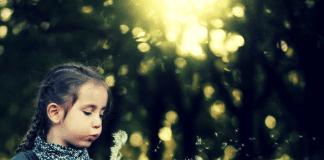 Photo of girl with dandelion clock