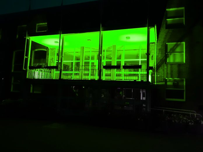 Guildhall front lit in green for Recycle Week 2021